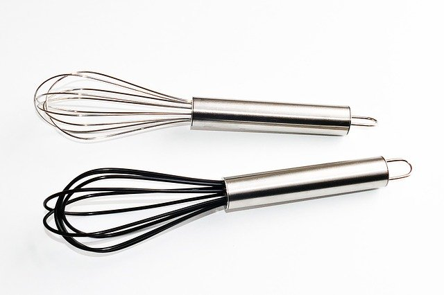 A close up of a whisk